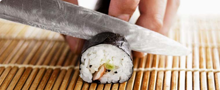 knife cutting sushi